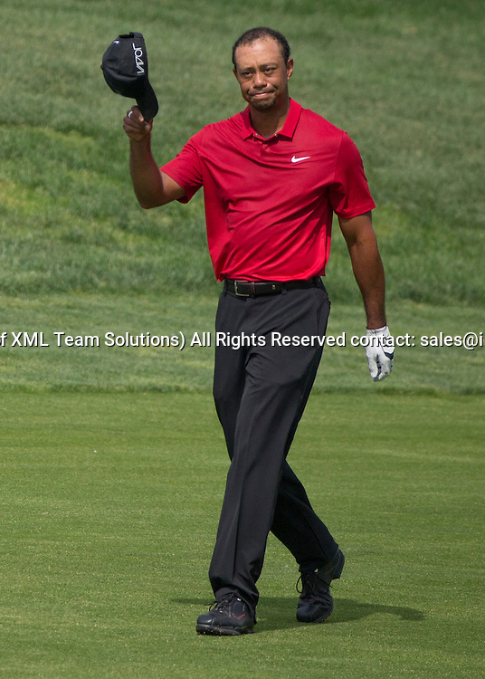 June 07 2015: Tiger Woods reacting to the crowed cheering him on the 18th hole during the final round of the Memorial Tournament held at the Muirfield Village Golf Club in Dublin, Ohio.