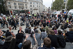 © London News Pictures. 30/10/2011. London, UK. Members of Occupy London and the public gather outside of St Paul's Cathedral today (30/10/2011) to watch and take part in a meeting between The Dean of St Paul's Graeme Knowles, the Bishop of London Dr Richard Chartres and the Occupy London group outside of St Paul's Cathedral.  Photo credit: Ben Cawthra/LNP