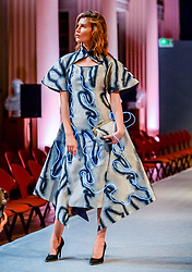 Pictured: Model Issy Johnston models a dress designed with fluorescent lights stitched into it, as part of the fashion collective show 'From Shanghai with Love' at the University of Edinburgh.<br /> <br /> © Dave Johnston / EEm