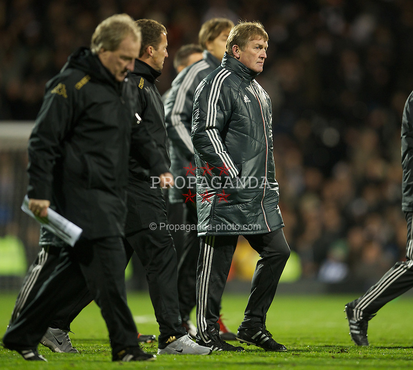 LONDON, ENGLAND - Monday, December 5, 2011: Liverpool's manager Kenny Dalglish looks dejected after his side lose 1-0 to Fulham during the Premiership match at Craven Cottage. (Pic by David Rawcliffe/Propaganda)