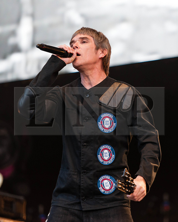 """© Licensed to London News Pictures. 07/06/2013. London, UK.   Ian Brown of The Stone Roses performing live at Finsbury Park. The Stone Roses are an English rock band formed in Manchester in 1983, consisting of vocalist Ian Brown, guitarist John Squire, bassist Gary """"Mani"""" Mounfield, and drummer Alan """"Reni"""" Wren. They were one of the pioneering groups of the Madchester movement that was active during the late 1980s and early 1990s.   Photo credit : Richard Isaac/LNP"""