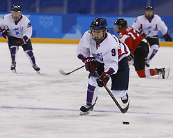 February 18, 2018 - Pyeongchang, KOREA - Korea forward Jongah Park (9) in a hockey game between Switzerland and Korea during the Pyeongchang 2018 Olympic Winter Games at Kwandong Hockey Centre. Switzerland beat Korea 2-0. (Credit Image: © David McIntyre via ZUMA Wire)