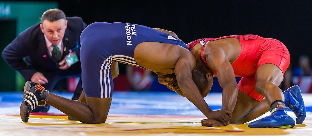 Action from the fight between Arnauld Essindi Sengui and John Mburu Kariuki at Glasgow 2014 (c) ROSS EAGLESHAM | SportPix.co.uk
