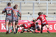 Niall Evalds & Logan Tomkins for Salford Reds try and stop Louis Anderson for Catalan Dragons scoring during the Betfred Super League match between Salford Red Devils and Catalan Dragons at the AJ Bell Stadium, Eccles, United Kingdom on 30 March 2018. Picture by George Franks.
