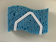 kitchen sponge hanging in holder