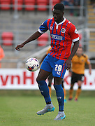 Dagenham player Ayo Obileye during the Sky Bet League 2 match between Dagenham and Redbridge and Newport County at the London Borough of Barking and Dagenham Stadium, London, England on 19 September 2015. Photo by Bennett Dean.