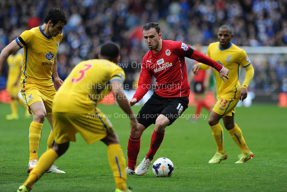Cardiff city's Jordon Mutch &copy; looks for a way through. Barclays Premier league match, Cardiff city v Crystal Palace at the Cardiff city stadium in Cardiff, South Wales on Saturday 5th April 2014.<br /> pic by Andrew Orchard, Andrew Orchard sports photography.