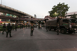© Licensed to London News Pictures. 26/05/2014. Thai army soldiers block a main entrance to Victory monument following a Anti-Coup protest in Bangkok Thailand. Today Thailand's King formally approved Thai army chief General Prayut Chan-O-Cha as head of the nation's new military junta.  Photo credit : Asanka Brendon Ratnayake/LNP