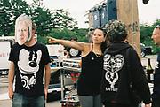 Man in Theresa May mask wearing Mickey Mouse t shirt next to pointing woman, Halfway Quarry Brecon Wales, May 2017