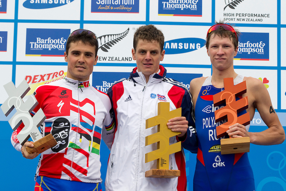 Spain's Javier Gomez, left, silver medal, with Great Britain's Jonathan Brownlee who won the world series and Russia's Dmitry Polyanskiy, bronze medal, after completing the Elite Men's Race of the World Triathlon Grand Final, Auckland, New Zealand, Sunday, October 21, 2012.  Credit:SNPA / David Rowland
