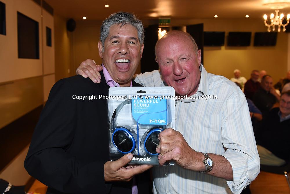 Fishing guru Geoff Thomas wins the Panasonic headphones. Mad Butcher Xmas Luncheon, Ellerslie Racecourse. Wednesday 17 December 2014. Photo: Andrew Cornaga / www.photosport.co.nz