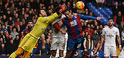 Lukasz Fabianski punches clear under pressure from Marouane Chamakh during the Barclays Premier League match between Crystal Palace and Swansea City at Selhurst Park, London, England on 28 December 2015. Photo by Michael Hulf.