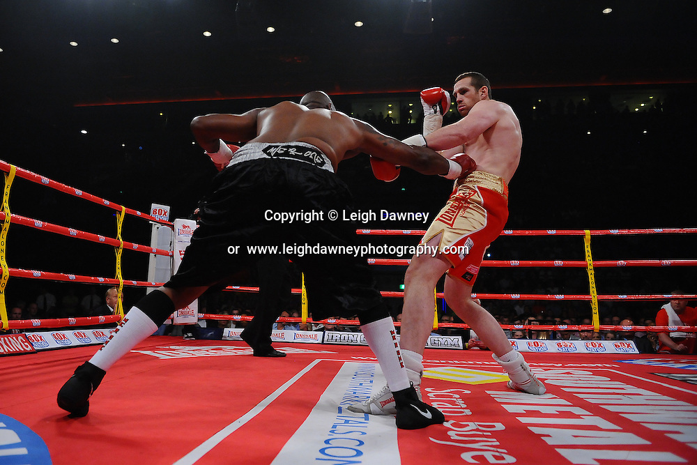 David Price trades blows with Tony Thompson at the Echo Arena, Liverpool on 6th July 2013. Credit: © Leigh Dawney Photography. Self Billing where applicable. Tel: 07812 790920