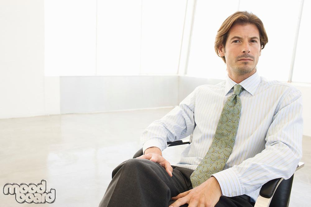Business man sitting chair, portrait