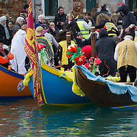VENICE, ITALY - FEBRUARY 16:  Rowers rest at the end of the traditional regatta which officially opens the Venice Carnival  on February 16, 2014 in Venice, Italy. The 2014 Carnival of Venice will run from February 15 to March 4 and includes a program of gala dinners, parades, dances, masked balls and music events.  (Photo by Marco Secchi/Getty Images)