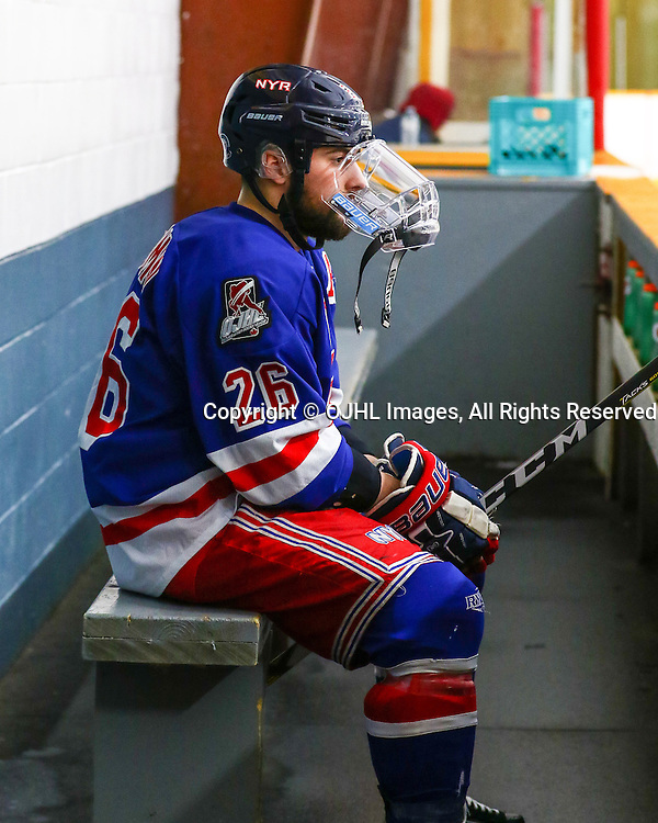 Trenton, ON - JAN 25,  2017: Ontario Junior Hockey League game between Buffalo and North York at the 2017 Winter Showcase, Adam Giacomin #26 of the North York Rangers sitting on the bench before start of the game.<br /> (Photo by Hark Nijjar/ OJHL Images)