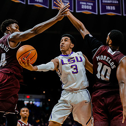 Jan 23, 2018; Baton Rouge, LA, USA; LSU Tigers guard Tremont Waters (3) shoots between Texas A&M Aggies forward Robert Williams (44) and center Tonny Trocha-Morelos (10) during the second half at the Pete Maravich Assembly Center. LSU defeated Texas A&M 77-65. Mandatory Credit: Derick E. Hingle-USA TODAY Sports