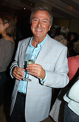 DES O'CONNOR at a party to celebrate the publication of Dot.Homme by Jane Moore held at Embassy Club, Old Compton Street, London on 14th July 2004.