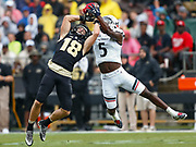 WEST LAFAYETTE, IN - SEPTEMBER 10: Cameron Posey #18 of the Purdue Boilermakers goes up for the ball as Mike Tyson #5 of the Cincinnati Bearcats makes the interception at Ross-Ade Stadium on September 10, 2016 in West Lafayette, Indiana.  (Photo by Michael Hickey/Getty Images) *** Local Caption *** Cameron Posey; Mike Tyson