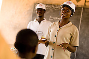 A community health nurse speaks about polio immunization at the Gbulahabila primary school in the village of Gbulahabila, northern Ghana on Wednesday March 25, 2009.