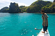 About to throw anchor in a remote cove just off the shore from El Nido Towan, Palawan, Philippines.