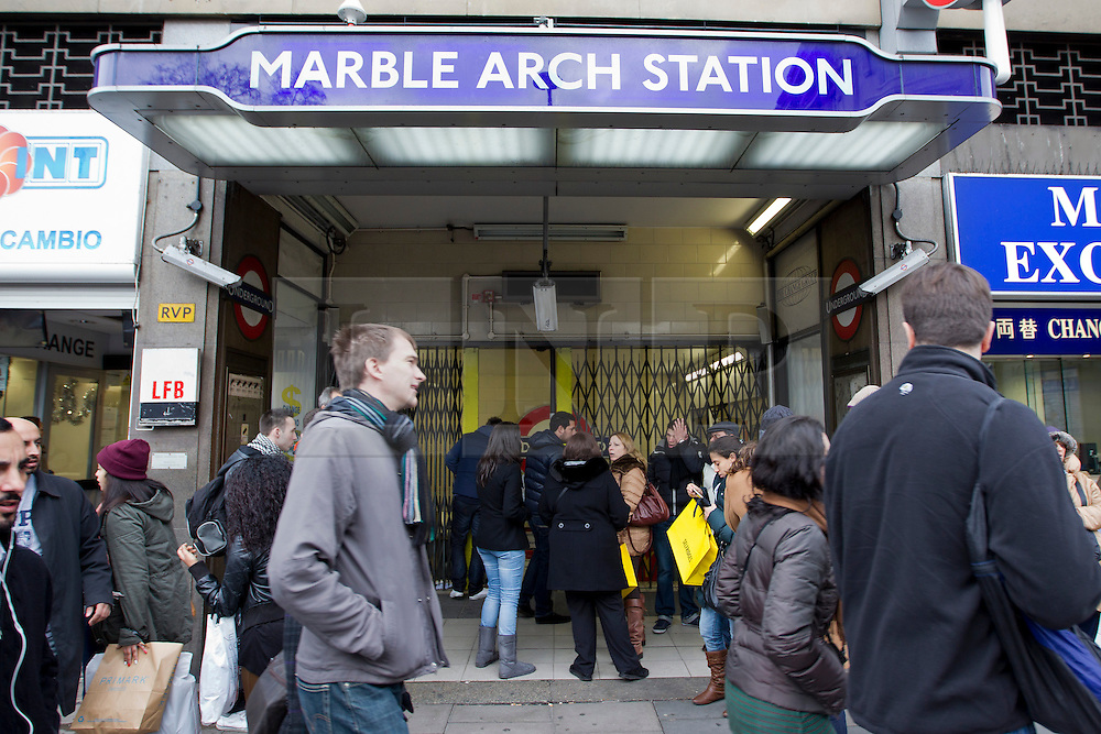 © Licensed to London News Pictures. 26/12/2012. London, UK. Shoppers walk past Marble Arch tube station today (26/12/12) as tube workers strike on Boxing day hitting thousands wanting to take advantage of Boxing Day sales in London. Photo credit: Matt Cetti-Roberts/LNP