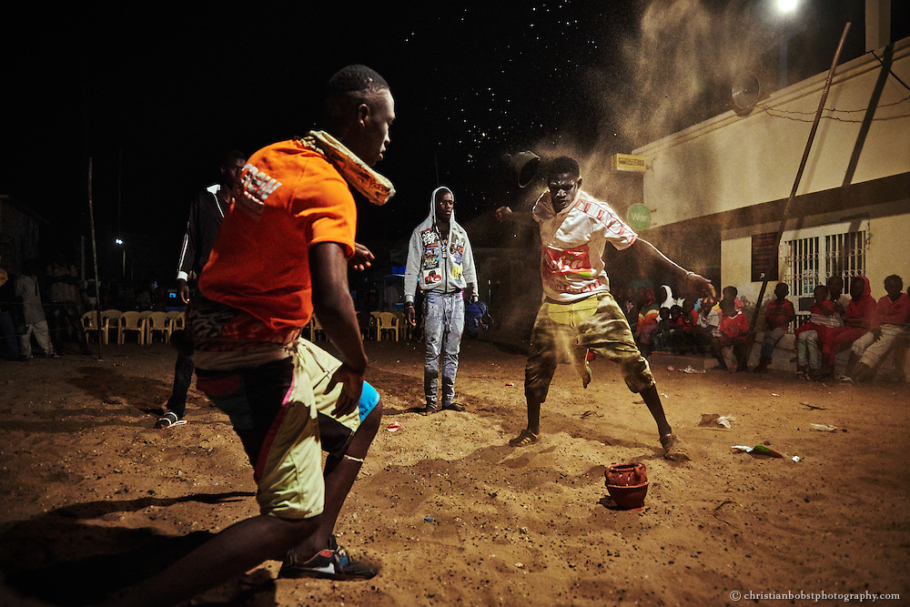 April 8, 2015. Young wrestlers prepare themselves with Gris-gris rituals for a competition in the Ngor district in Dakar, which was organised by the Wrestler Kherou Ngor.