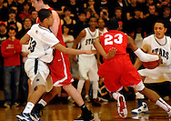 5 MARCH 2011 -- NORMANDY, Mo -- Chaminade College Prep basketball player Bradley Beal (23) slips behind a screen from teammate Brendan Kelly (31) to split through the McCluer North High School defense during the MSHSAA Class 5 boys basketball quarterfinals at Mark Twain Hall on the University of Missouri - St. Louis campus in Normandy, Mo. Saturday, March 5, 2011. The Stars upset the Red Devils 57-56 to advance to MSHSAA semifinals. Image © copyright 2011 Sid Hastings.