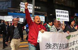 December 18, 2018 - Hong Kong, CHINA - Pro-China demonstrators march to the Canadian Consulate General in Central calling for immediate releasing of Meng Wanzhou. (Credit Image: © Liau Chung-ren/ZUMA Wire)