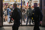 Shopper shide inside locked stores -Armed police flood the Oxford Circus area after an incident caused the station to be cleared.