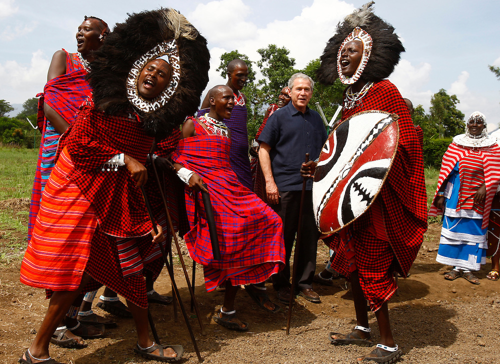 U.S. President George W. Bush (2nd R) watches traditional Africa warriors perform during a visit to Maasai Girls School in Arusha, Tanzania, February 18, 2008.  Reuters/Jim Young