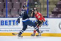 PENTICTON, CANADA - SEPTEMBER 16: Ryan Lomberg #56 of Calgary Flames checks Matt Murphy #87 of Winnipeg Jets on September 16, 2016 at the South Okanagan Event Centre in Penticton, British Columbia, Canada.  (Photo by Marissa Baecker/Shoot the Breeze)  *** Local Caption *** Matt Murphy; Ryan Lomberg;