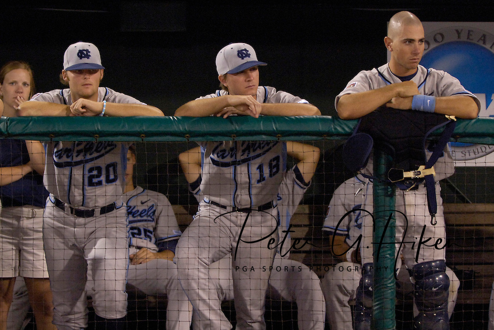 North Carolina players (L-R) Robert Woodard, Mike Facchinei and Benji Johnson, stand dejectedly in the dugout after losing to Oregon State in the National Championship game in the College World Series.  The Beavers beat the Tar Heels 3-2 at Rosenblatt Stadium in Omaha, Nebraska, June 26, 2006.