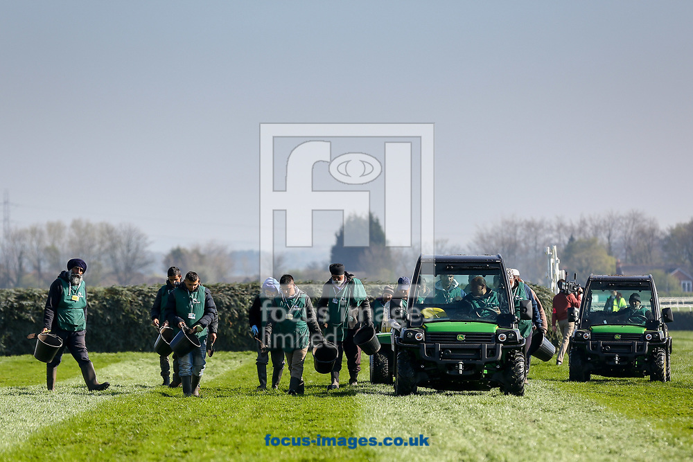 Ground staff prepare the course on Grand National Day of the Randox Grand National Festival at Aintree Racecourse, Liverpool<br /> Picture by Mark Chappell/Focus Images Ltd +44 77927 63340<br /> 08/04/2017