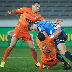 Nicolas Sanchez and Joaquin Tuculet tackle Matt Duffie during the Super Rugby match between the Blues and Jaguares at Eden Park in Auckland, New Zealand on Friday, 28 April 2018. Photo: Dave Lintott / lintottphoto.co.nz
