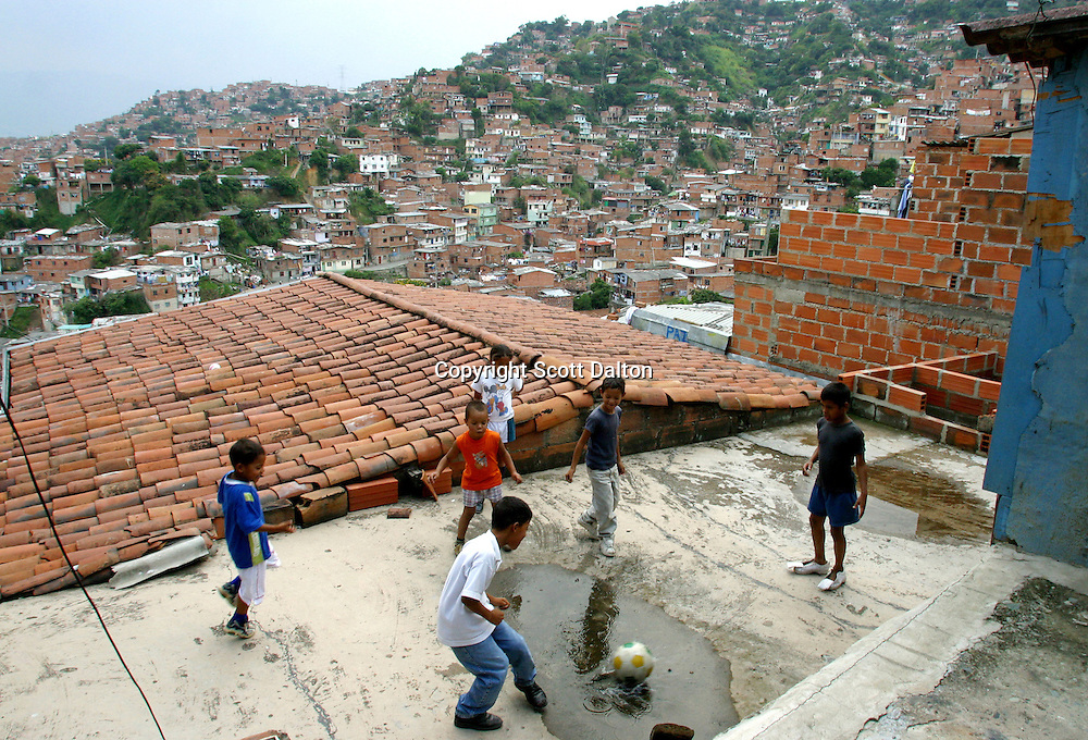 Boys play soccer on a rooftop in Comuna 13, in Medellin. The residents of the barrio have had to endure years of turmoil at the hands of armed groups in Colombia's civil war. (Photo/Scott Dalton)