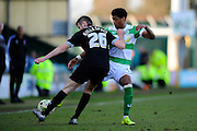 Carlisle Utd's Macaulay Gillesphey and Yeovil Town's Shaun Jeffers during the Sky Bet League 2 match between Yeovil Town and Carlisle United at Huish Park, Yeovil, England on 25 March 2016. Photo by Graham Hunt.