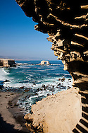 "The rugged Pacific Ocean coast and the ""Portal"" rock formation near Antofagasta, Chile"
