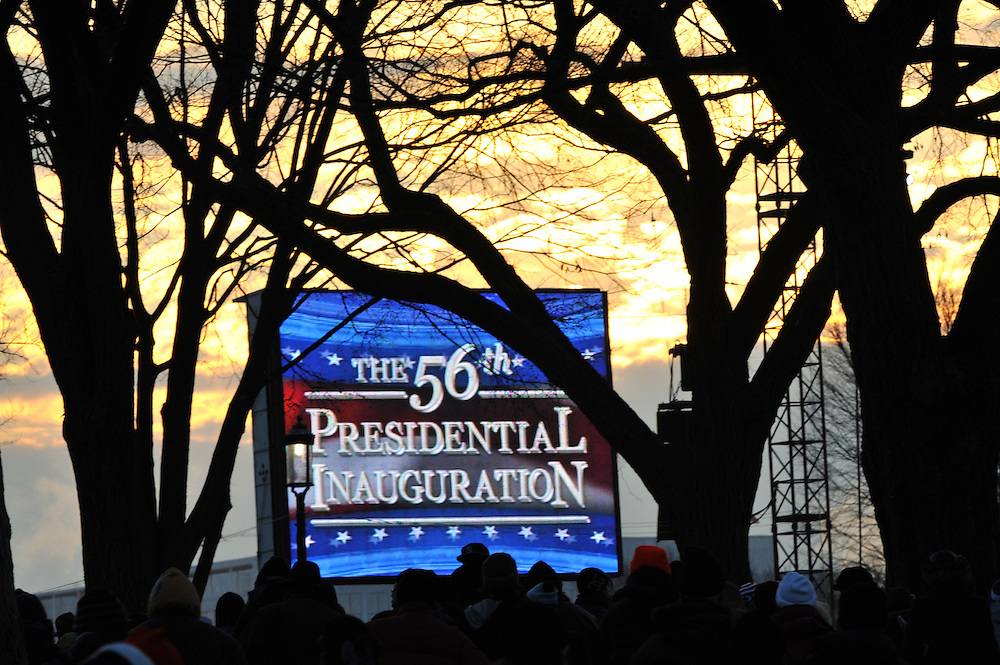 Sunrise paints the sky yellow, greeting the early arrivals for Barack Obama's historic Presidential inauguration near the Washington Monument.  An estimated two million people flocked to Washington D.C. for the ceremony, enduring freezing temperatures to witness Obama take the oath of office becoming the first African-American to become President, the 44th in the history of the United States of America.