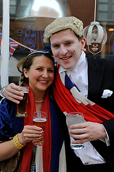 Brighton, UK. 29/04/2011. The Royal Wedding of HRH Prince William to Kate Middleton. A couple dressed in honour of the Royal Wedding at the street party in Gloucester Road Brighton. Photo credit should read: Peter Webb/LNP. Please see special instructions for licensing information. © under license to London News Pictures