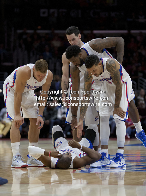 Jan. 5, 2015 - Los Angeles, California, U.S - Team mates look to the injured Chris Paul #3 of the Los Angeles Clippers during their NBA game against the Atlanta Hawks at the Staples Center in Los Angeles, California on Monday, January 5, 2015. Hawks defeat Clippers 107-98