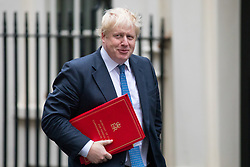 © Licensed to London News Pictures. 05/12/2017. London, UK. Foreign and Commonwealth Secretary Boris Johnson arriving in Downing Street to attend a Cabinet meeting this morning.Yesterday, Brexit negotiations on the Northern Ireland border were stalled when Arlene Foster of the DUP said she could not support commitment to keep Northern Ireland aligned with EU laws. Photo credit : Tom Nicholson/LNP