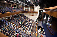 People tour the 482-seat auditorium and orchestra pit at the open house for the Coralville Center for the Performing Arts in Coralville on Saturday, August 27, 2011.