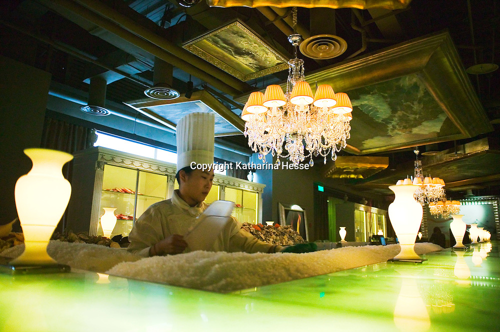 BEIJING, JANUARY-19: a chef cleans the lobster bar  of the LAN Club, the latest addition to Beijing's high-end venues, January 19, 2007...The LAN was designed by Phillipe Starck and spans 6000 square metres.