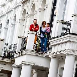 London, UK - 27 August 2012: spectators watch the parade from a balcony during the annual Notting Hill Carnival.