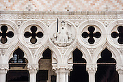 """The Doge's Palace, built in gothic style 1309-1424 AD, housed the elected leader and government of the Republic of Venice, until Napoleon occupied in 1797. See this detail of the Doge's Palace from the Piazzetta, which extends Piazza San Marco (Saint Mark's Square) to the Venetian Lagoon waterfront. The romantic """"City of Canals"""" stretches across 100+ small islands in the marshy Venetian Lagoon along the Adriatic Sea in northeast Italy. The Republic of Venice was a major maritime power during the Middle Ages and Renaissance, a staging area for the Crusades, and a major center of art and commerce (silk, grain and spice trade) from the 1200s to 1600s. The wealthy legacy of Venice stands today in a rich architecture combining Gothic, Byzantine, and Arab styles. Venice and the Venetian Lagoons are on the prestigious UNESCO World Heritage List. Panorama stitched from 12 overlapping photos."""