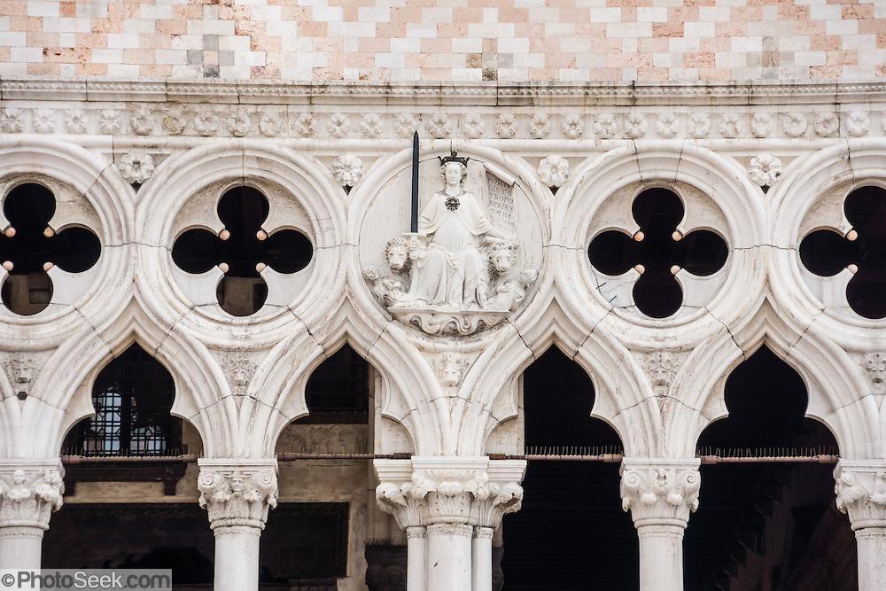 "The Doge's Palace, built in gothic style 1309-1424 AD, housed the elected leader and government of the Republic of Venice, until Napoleon occupied in 1797. See this detail of the Doge's Palace from the Piazzetta, which extends Piazza San Marco (Saint Mark's Square) to the Venetian Lagoon waterfront. The romantic ""City of Canals"" stretches across 100+ small islands in the marshy Venetian Lagoon along the Adriatic Sea in northeast Italy. The Republic of Venice was a major maritime power during the Middle Ages and Renaissance, a staging area for the Crusades, and a major center of art and commerce (silk, grain and spice trade) from the 1200s to 1600s. The wealthy legacy of Venice stands today in a rich architecture combining Gothic, Byzantine, and Arab styles. Venice and the Venetian Lagoons are on the prestigious UNESCO World Heritage List. Panorama stitched from 12 overlapping photos."