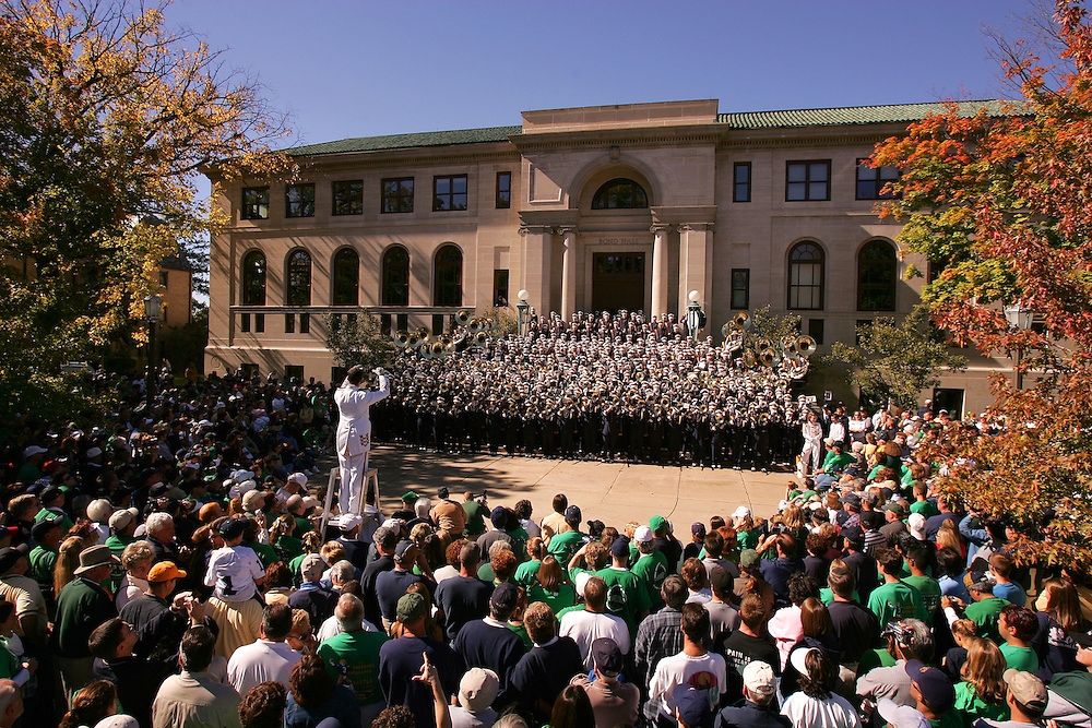 The Notre Dame Marching Band performs on the steps of Bond Hall before a home football game.
