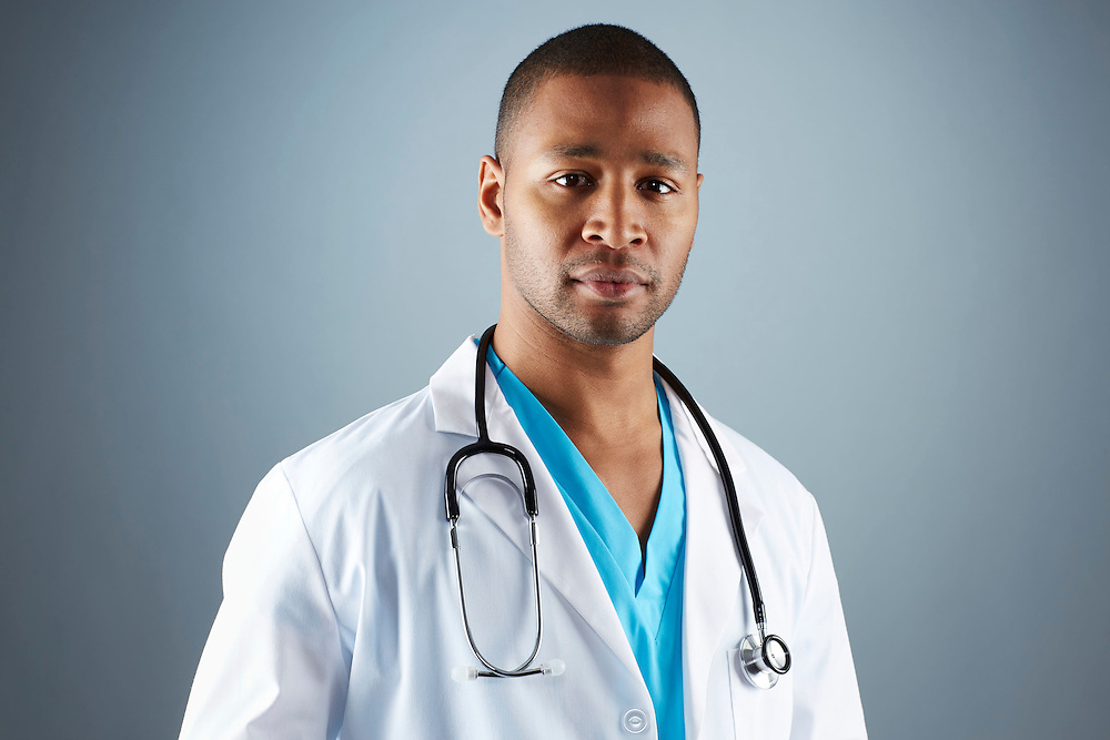 A portrait series representing the intense emotions that Doctors face.  An African American male Doctor wearing a white lab coat, stethoscope, and blue medical scrub suit shown.