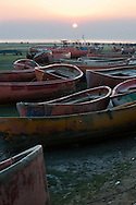 The beach outside Ward 11 in Chittagong, Bangladesh is filled with old boats that are moored away from the beach. These boats are full of color, and enliven the passage of the beachgoers as they walk to the sand.